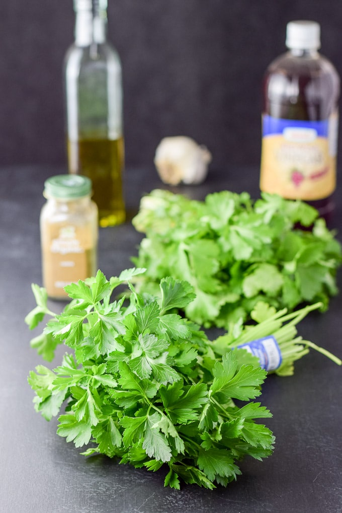 Parsley, Cilantro, cumin, red wine vinegar, garlic and oil for the cheer for chimichurri sauce