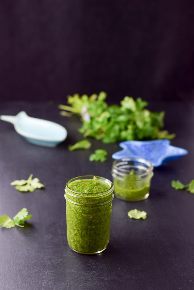 cheer for chimichurri sauce poured into the jars and ready to be eaten
