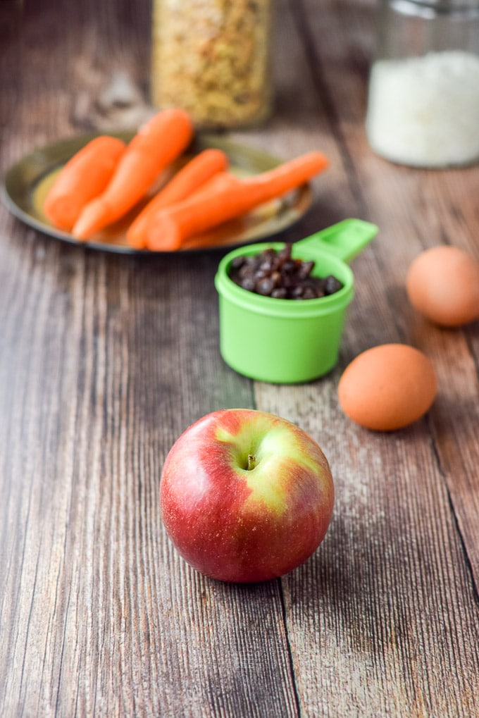 Apple, carrots, raisins, eggs, walnuts and coconut for the muffins