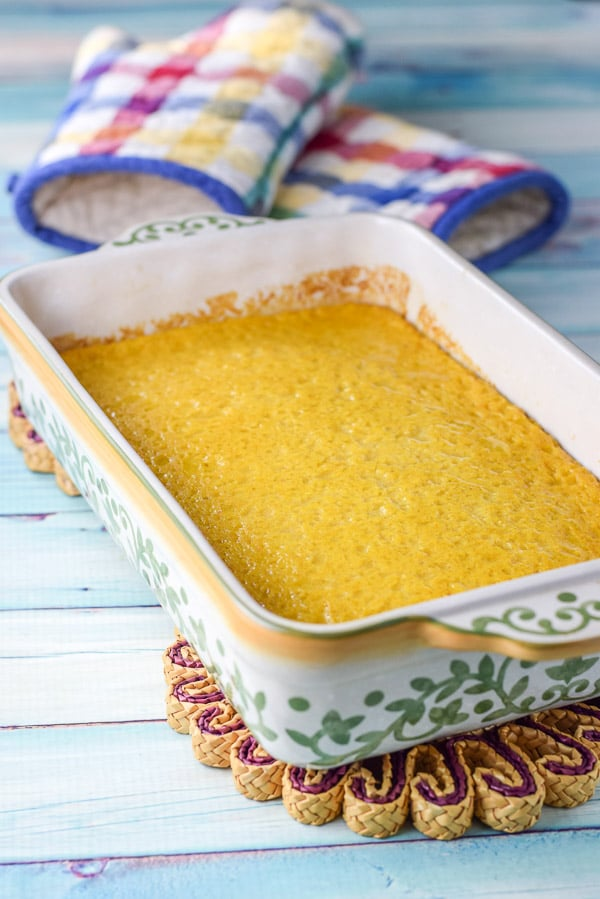 The yellow souffle fresh out of the oven still in the baking dish