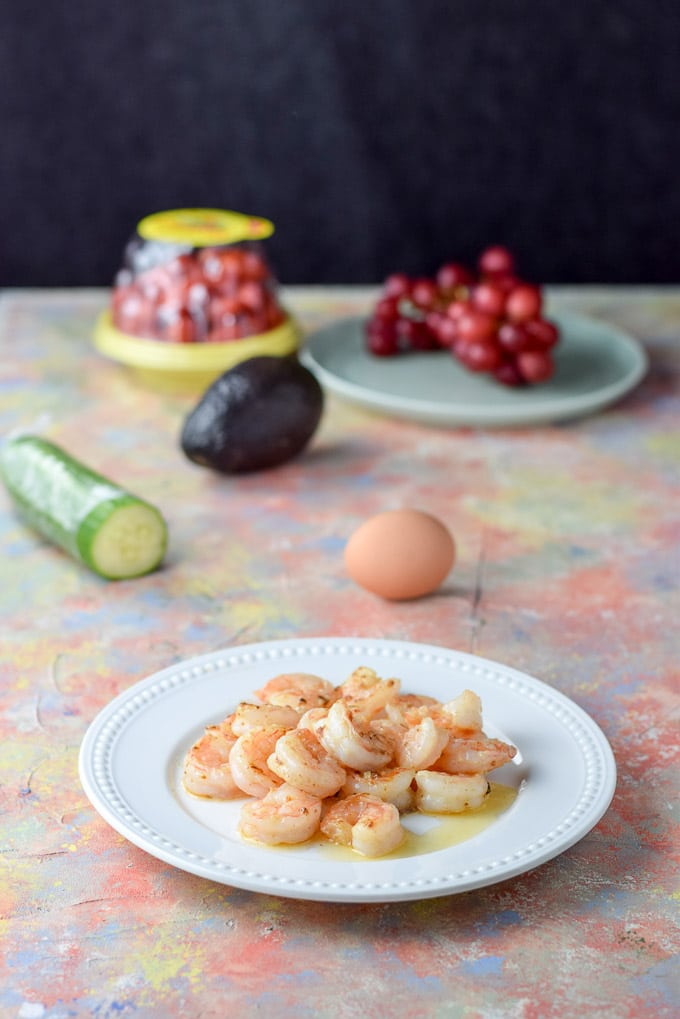 Sauted shrimp, egg, cucumber, tomatoes and grapes for the Smorgasbord Garlic Shrimp Salad