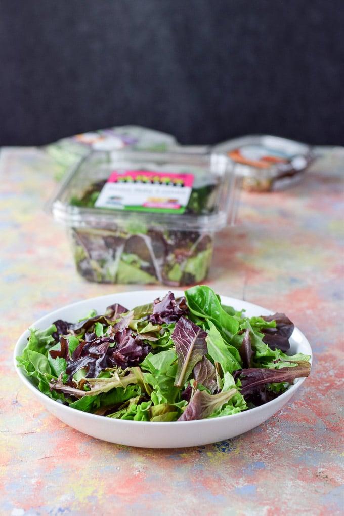 Lettuce in the bowl for the Smorgasbord Garlic Shrimp Salad