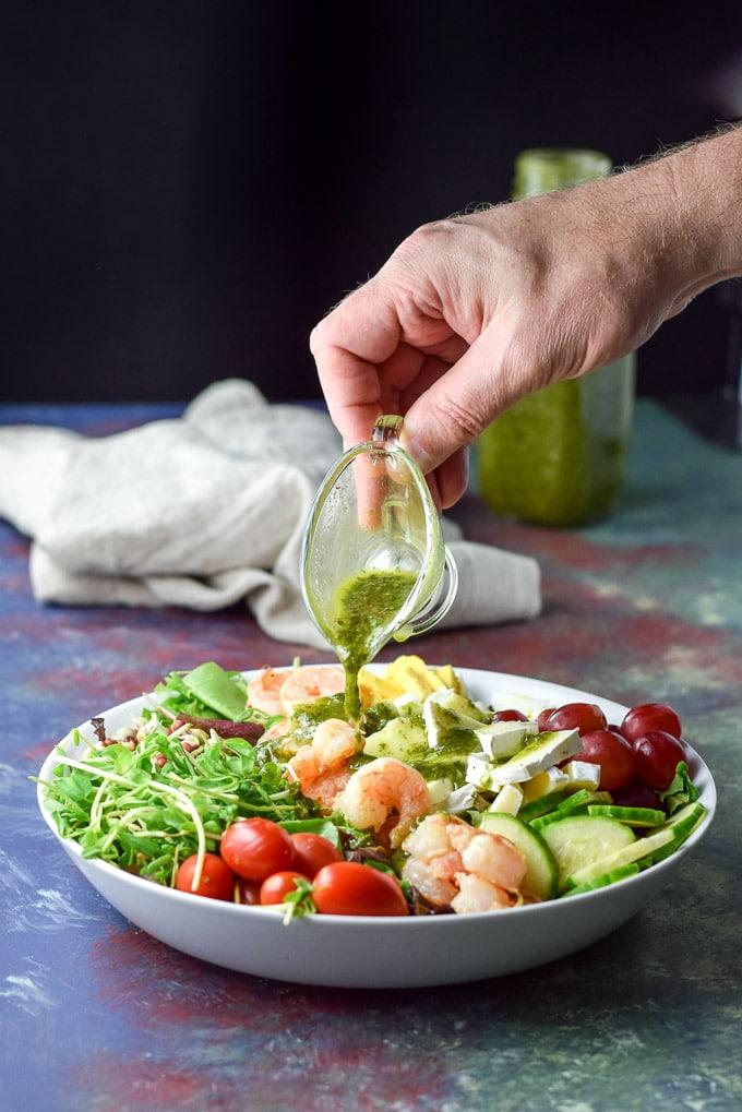 Chimichurri dressing poured for the Smorgasbord Garlic Shrimp Salad