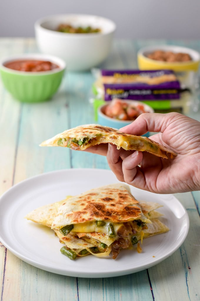 Bite take out of the deliciously cheesy vegetarian quesadillas