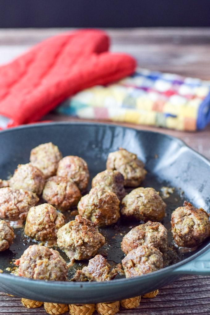 Meatballs sautéed in a cast iron sauté pan