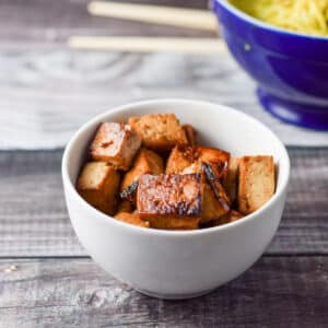 A bowl of tofu, another of noodles - square