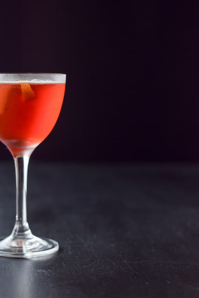 Vertical view of half of the balanced Boulevardier cocktail