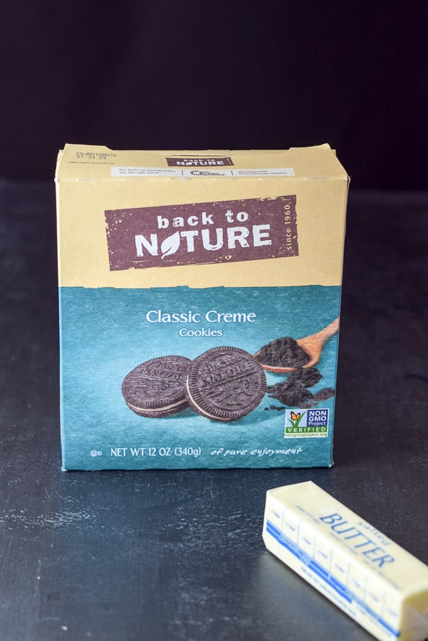 Chocolate creme cookies and butter on a black table