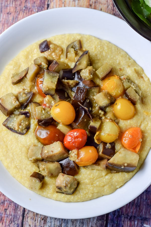 Over head shot of the polenta with tomatoes and eggplant on top