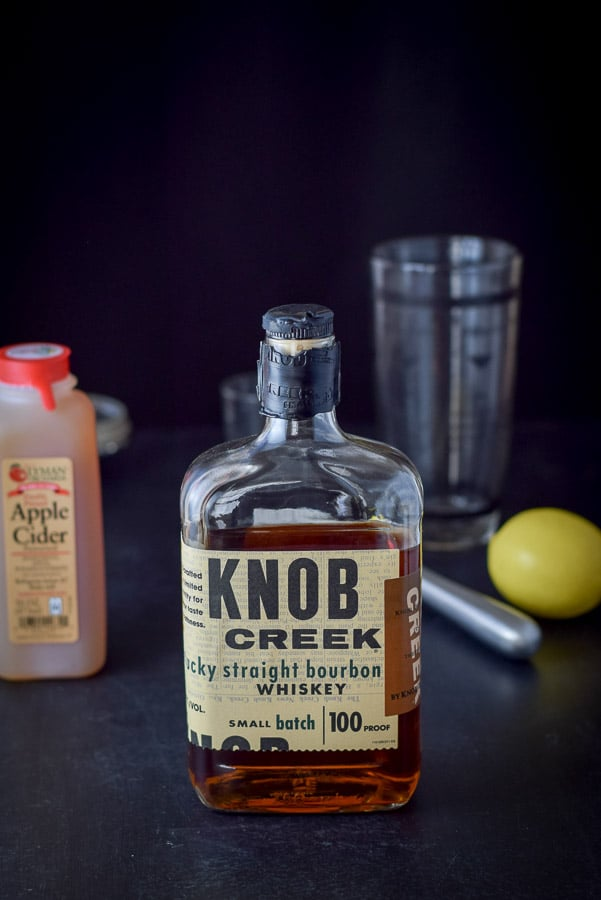 Knob creek bourbon, apple cider, lemon for the apple cider bourbon smash cocktail