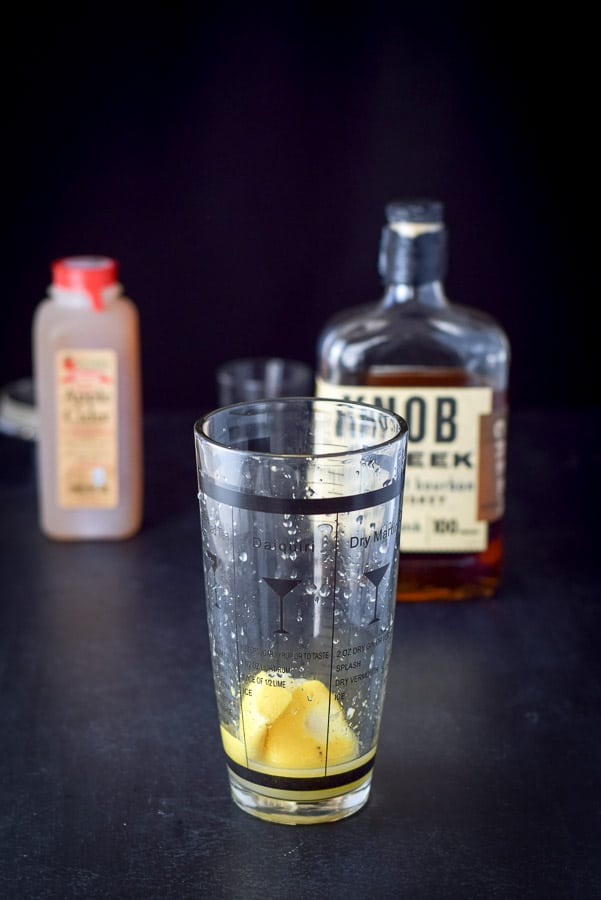 Muddled lemon half in my shaker for the apple cider bourbon smash cocktail