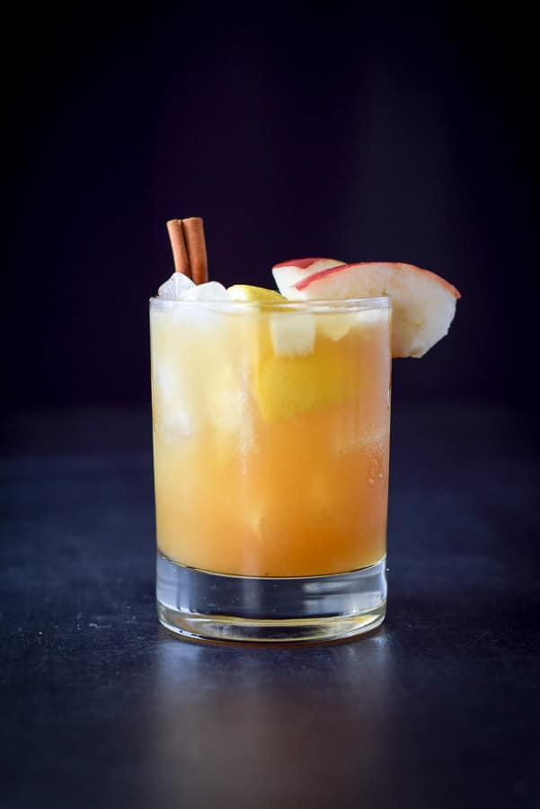 Vertical view of the apple cider bourbon smash cocktail - gold and pretty