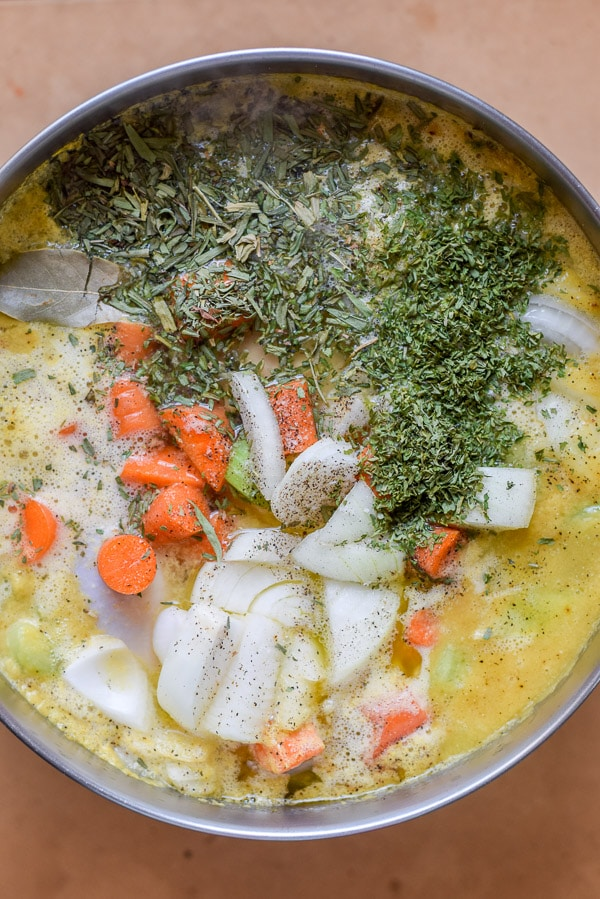 Overhead view of all the ingredients in the pan for the soup