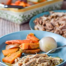 The perfectly delectable pulled pork plated with baked vegetables