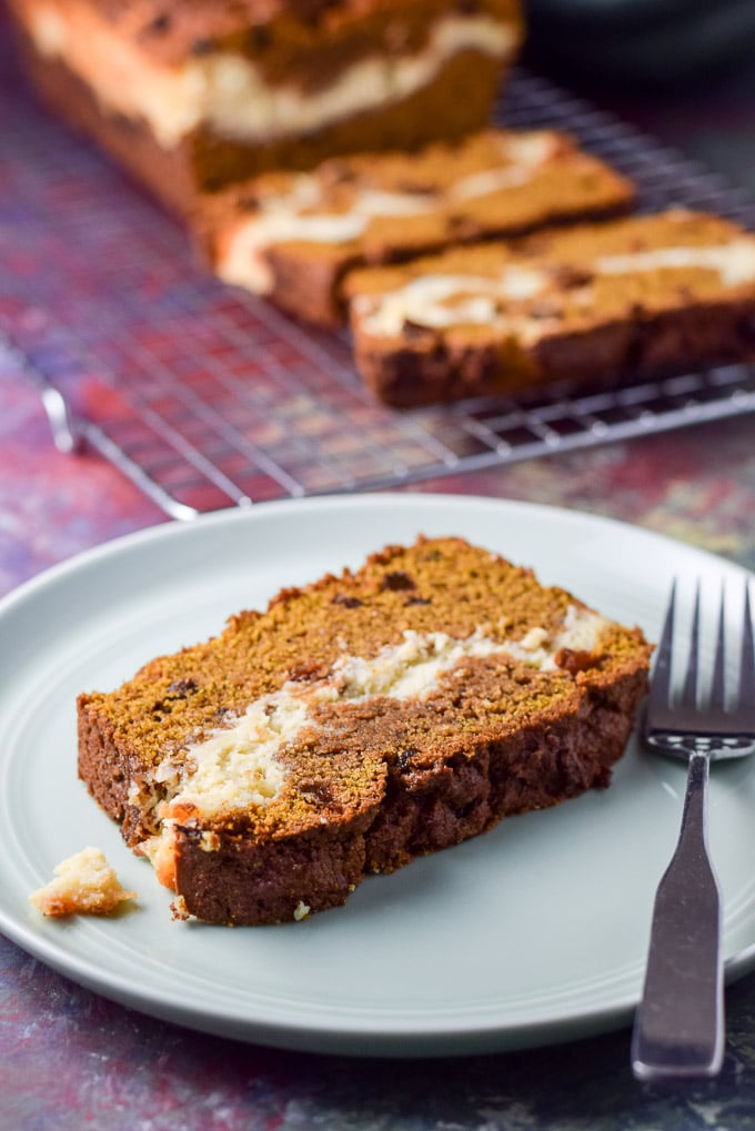 Close up of the pumpkin bread and a fork on the plate