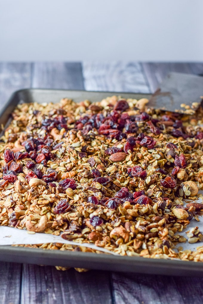 Chocolate mixed in the pan of granola and cranberries on top
