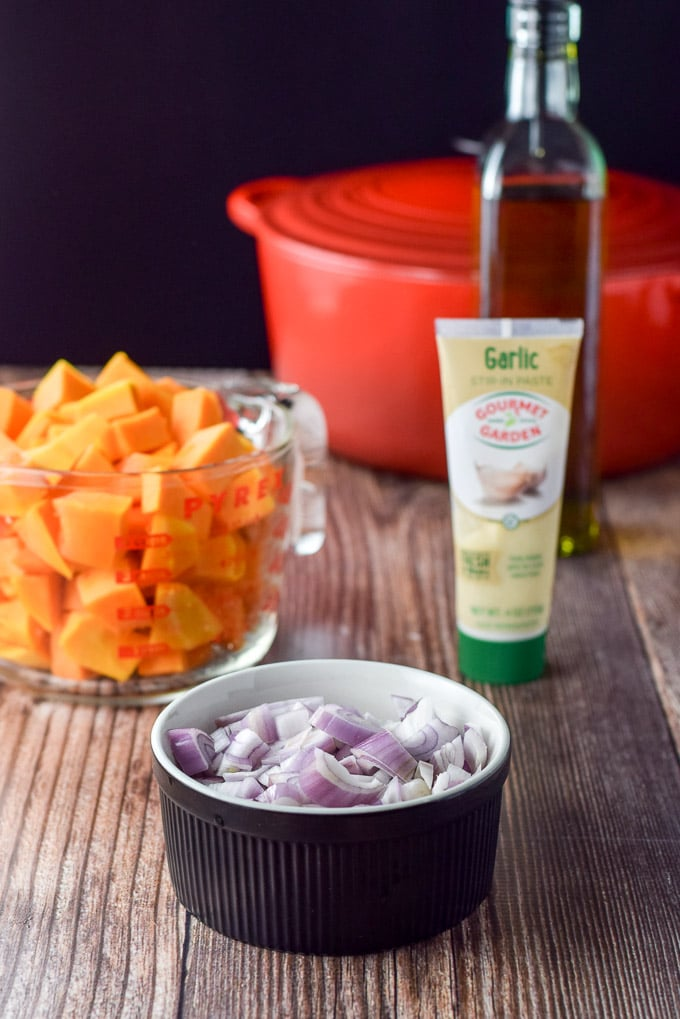 Shallots, cut squash, garlic paste and olive oil for the easy butternut squash soup