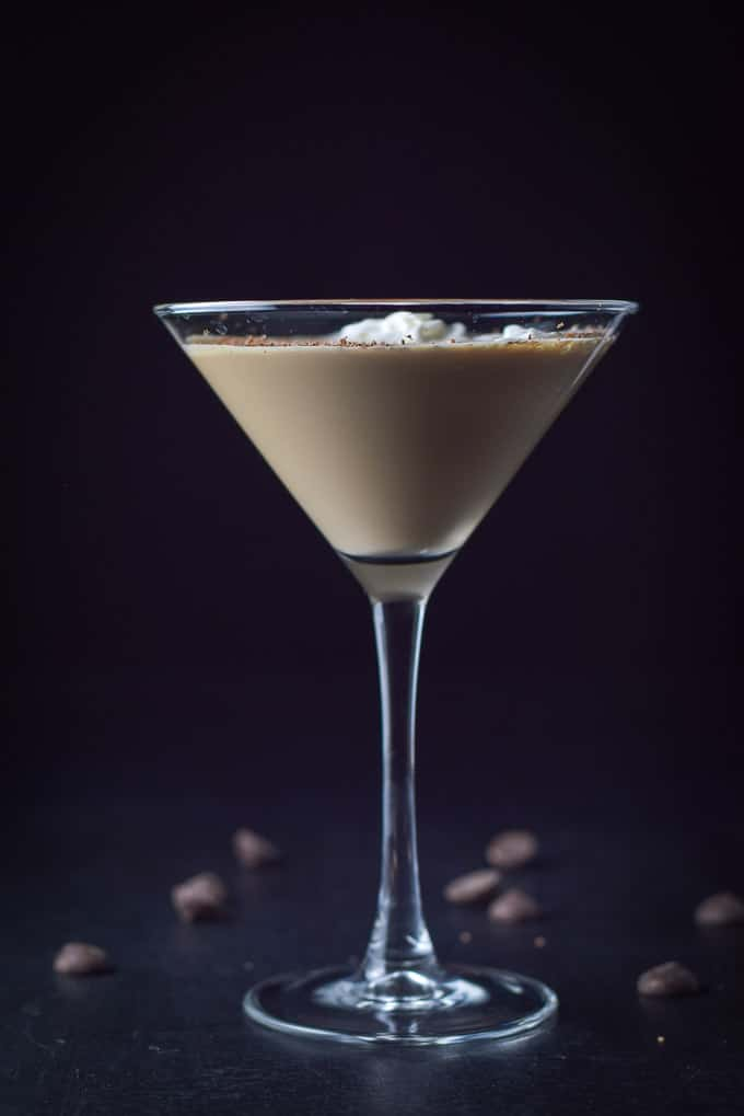 Vertical view of the chocolate cocktail with dollops of whipped cream