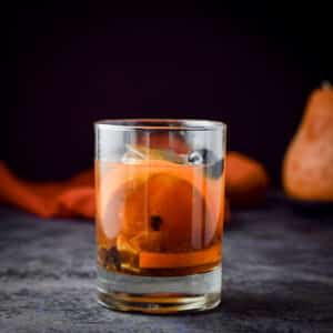 Old fashioned cocktail in vertical view - square