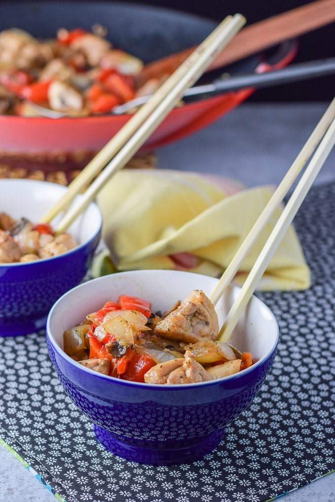 Bowl of simple stir fry chicken in a bowl with chop sticks in the bowl!