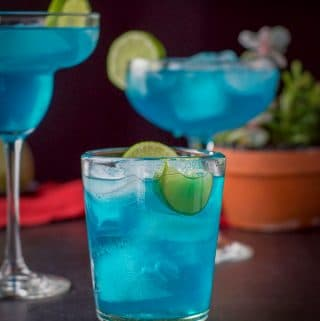 vertical view of the three glasses of the electric blue margarita
