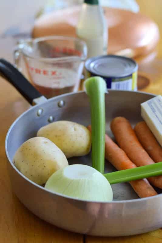 Onion, celery, carrots in a pan