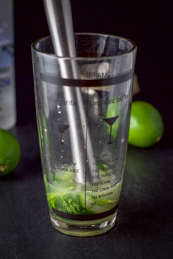 Cucumbers, mint, simple syrup and lime juice muddled in the cocktail shaker