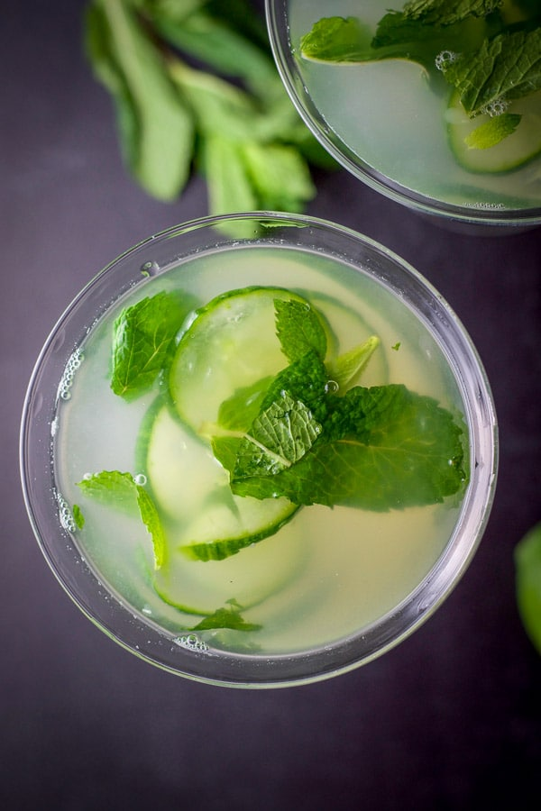 Overhead shot of the martinis with cucumbers and mint floating in them