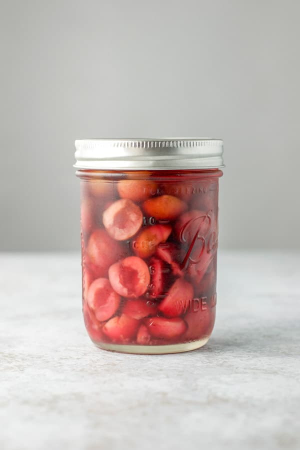 Sealed jar of vodka and cherries for the cherry infused vodka