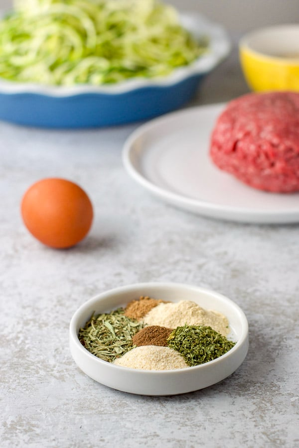 Herbs, spices, egg and beef for the Swedish meatballs with sour cream sauce