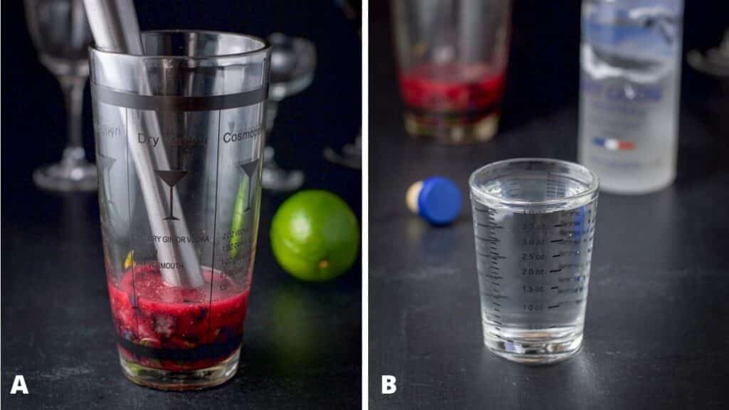 A shaker filled with muddled mint and blueberry and vodka measured out with the bottle in the background