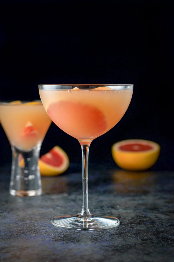 Vertical view of the cosmos with some sliced grapefruit in the background