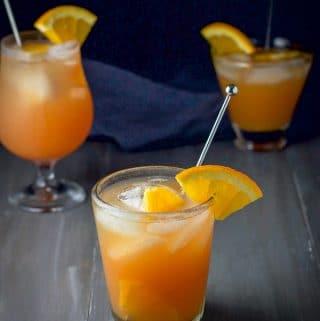 Rum swizzle in three different glasses