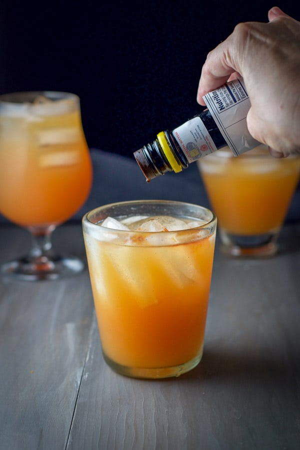 Angostura bitters being shaken in the cocktail
