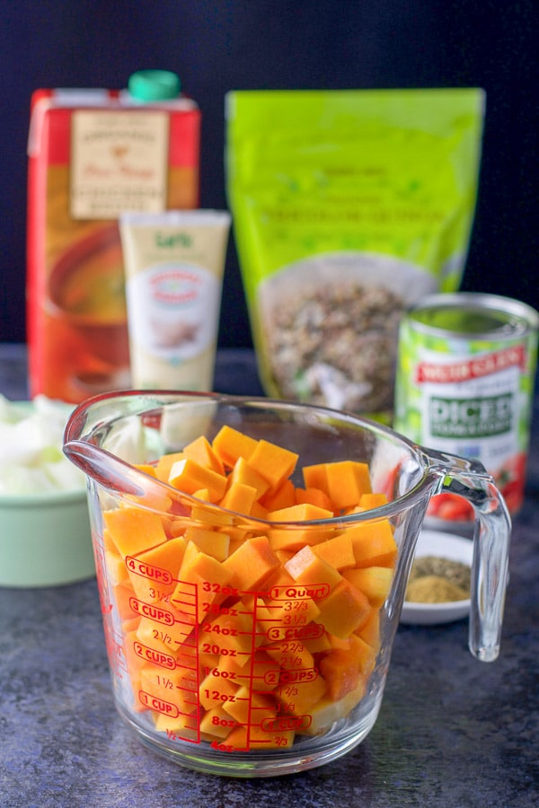 Chopped squash in a measuring cup in front of the rest of the ingredients