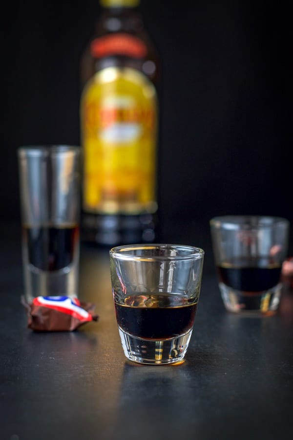 Kahlúa poured out in the three glasses
