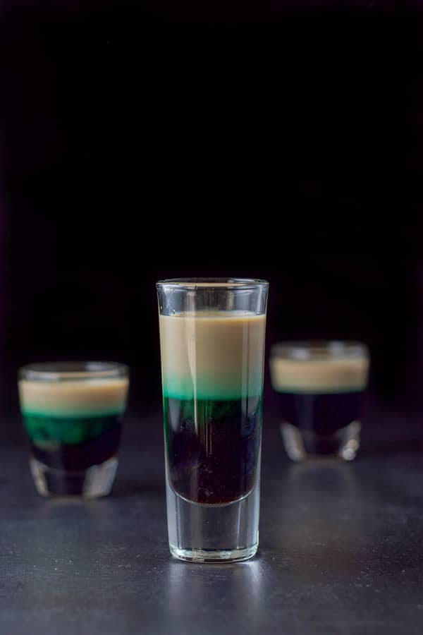 Tall glass filled with the after eight shot in front