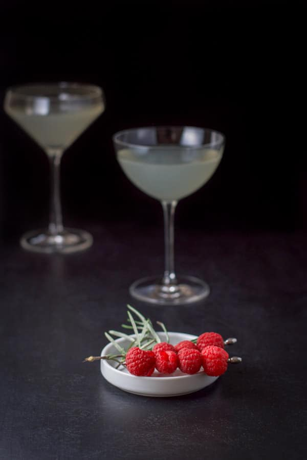 Raspberries on skewers and rosemary as garnish for the mistletoe martini