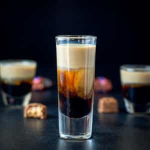 Tall glass of snickers shot - square