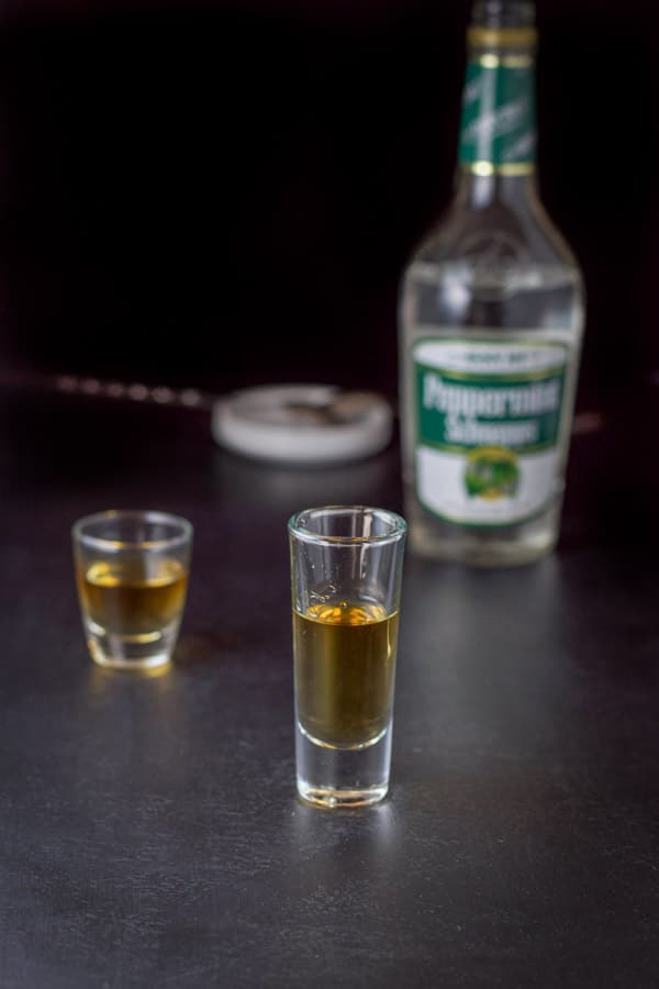 Peppermint schnapps layered in with the bottle, spoon and pourer