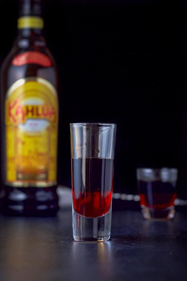 Kahlúa layered into the glass for the chocolate covered cherry shot