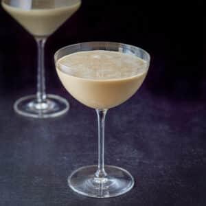 A eggnog martini in a curved glass - square