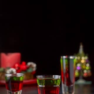 Vertical view of the Christmas shot - three glasses filled with the delicious shot