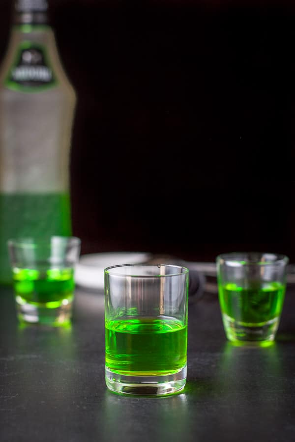 Midori poured into the glasses with the bottle in the background