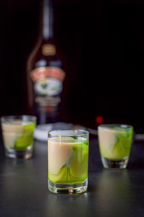Baileys layered into the glasses with the bottle in the background