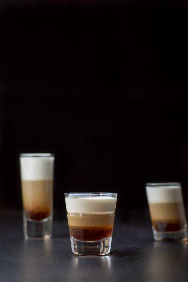 Vertical view of the three glasses filled with the shot