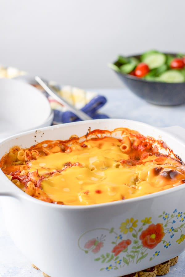 A cheesy crust on the pasta in a casserole dish straight out of the oven