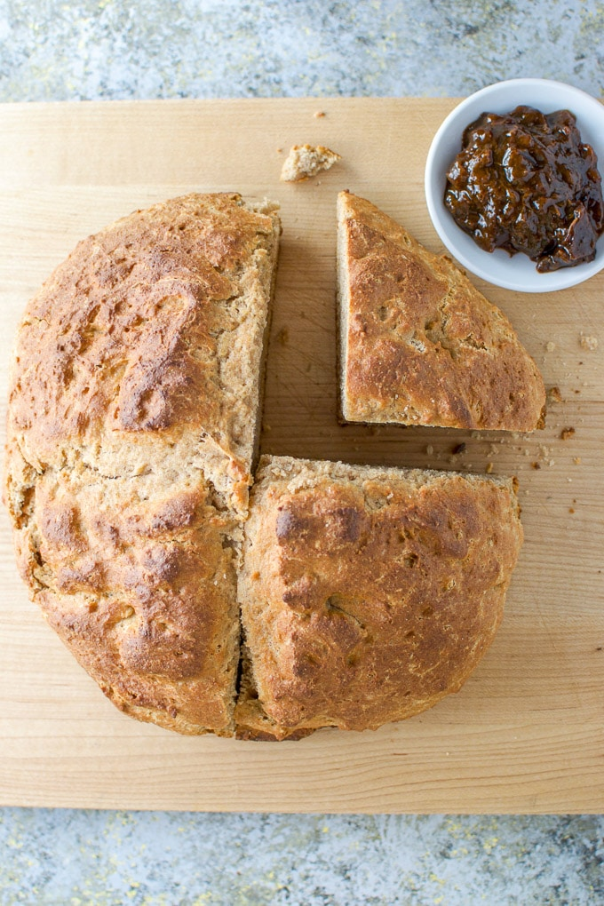 Overhead shot of the loaf of Irish soda bread cut in fourths