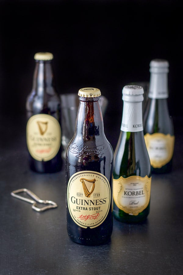 Guinness and champagne along with an opener on the table