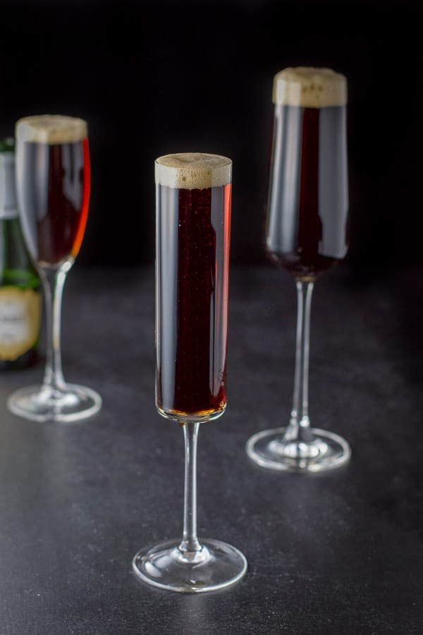 Champagne poured over the Guinness in the three glasses